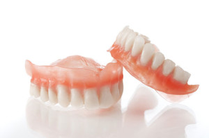 Фиксация и стабилизация съемных пластиночных протезов